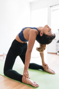 young woman doing gotrayne yoga at home